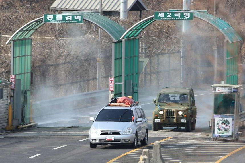 Vehicles transit near the inter-Korean border from the Kaesong Industrial Complex, North Korea on Feb 11, 2016.