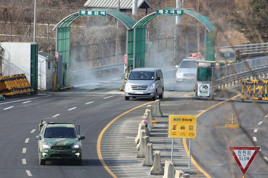 Vehicles transiting near the inter-Korean border from the Kaesong Industrial Complex, North Korea.