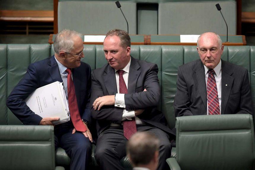 Australian Prime Minister Malcolm Turnbull (left) speaking to Australian Agriculture Minister Barnaby Joyce.