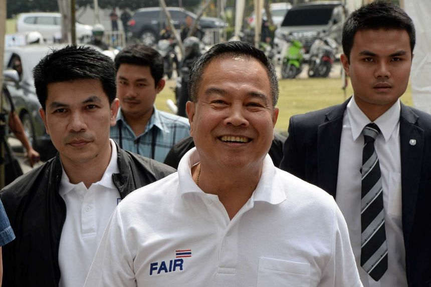 Former Thai national police chief Somyot Poompanmoung (centre) has been elected as president of the Football Association of Thailand.