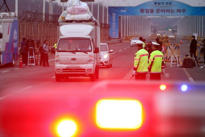A vehicle leaving the Kaesong joint industrial zone passing through a military checkpoint in Paju on Feb 11, 2016. North Korea on Feb 11 ordered the immediate expulsion of all South Koreans from the jointly-run Kaesong industrial zone and the seizure