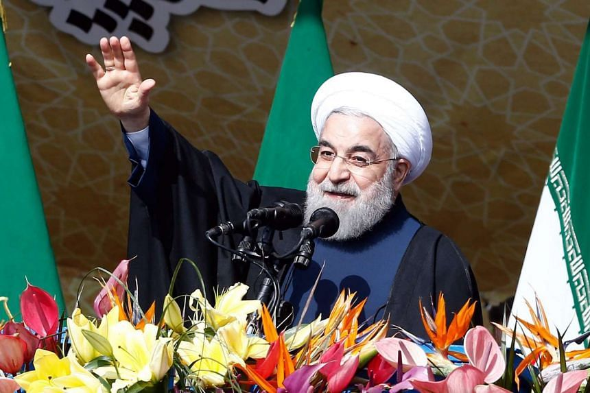Iranian President Hassan Rouhani waves to the crowd during a ceremony marking the 37th anniversary of the 1979 Islamic revolution in Teheran on Feb 11, 2016.