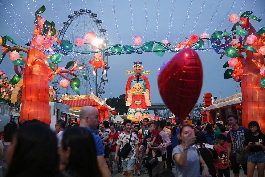 Above left: In line with the Year of the Monkey, the decorations included elements of Journey To The West, a classic Chinese story featuring the Monkey God, seen here in the form of a large sculpture. Above right: This year's River Hongbao, which sta