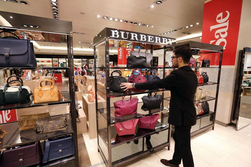 An employee arranges women's handbags in the Burberry Group Plc boutique at the Central Universal Department Store, in Moscow, on Jan 31, 2016.
