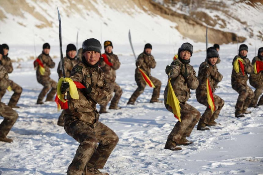 Soldiers of China's People's Liberation Army take part in winter training at temperatures around minus 30 deg C in Heilongjiang province, Jan 31, 