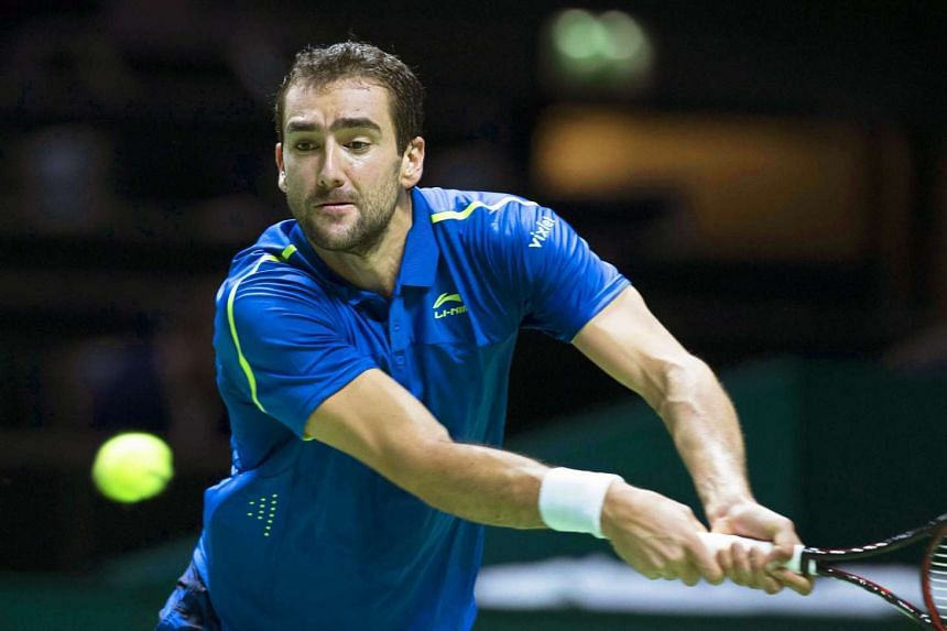 Croatia's Marin Cilic returns the ball to Luxembourg's Gilles Muller.