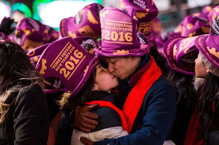 A couple kiss while waiting to celebrate the new year in New York's Times Square on Dec 31, 2015.