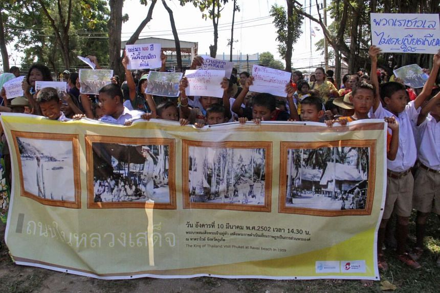 Sea Gypsy children holding placards and banners during a protest against a land dispute on Phuket Island, Thailand, on Jan 27, 2016.