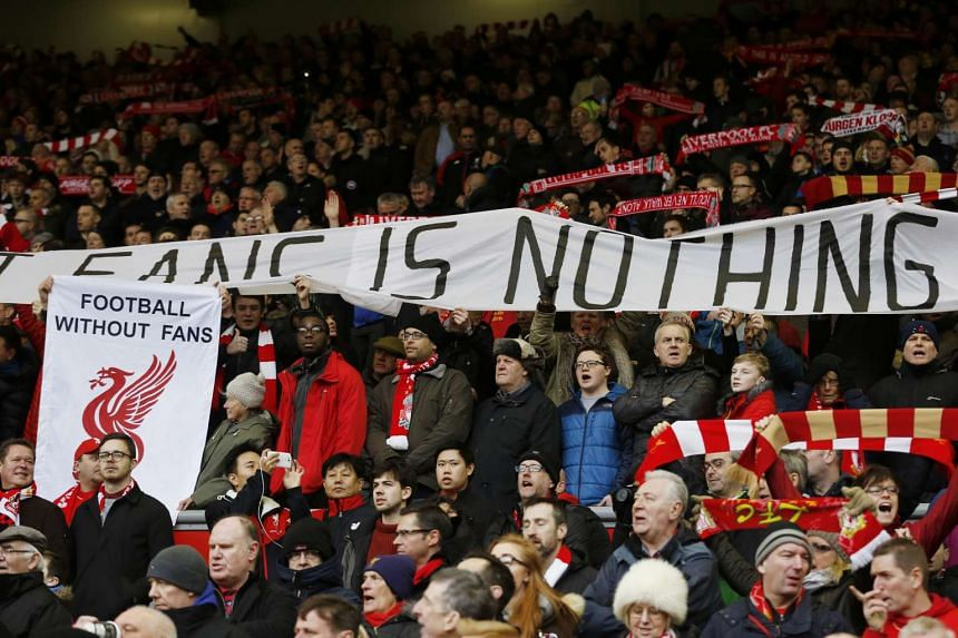 Liverpool fans hold up signs in protest against ticket prices on Feb 6, 2016..