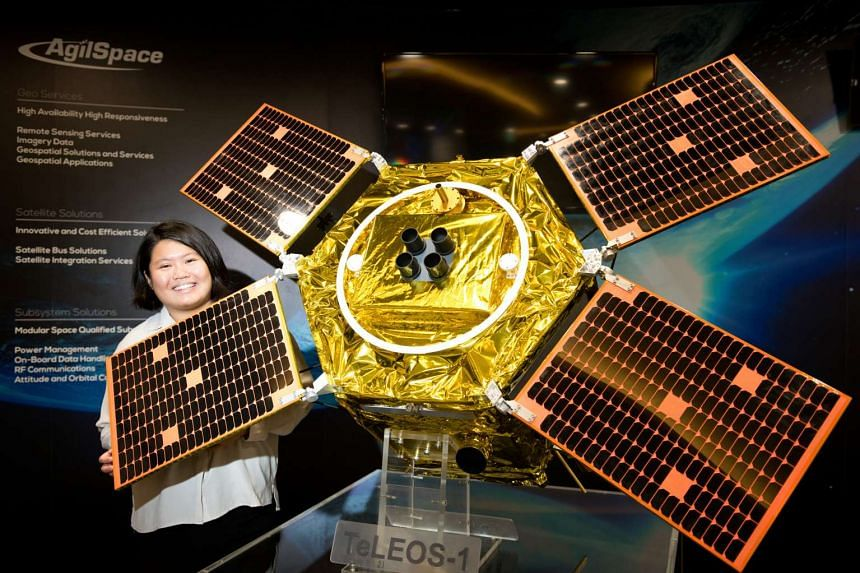 Senior engineer Grace Parn at ST Electronics (Satellite Systems) poses with a TeLEOS-1 model, the first made-in-Singapore commercial satellite.