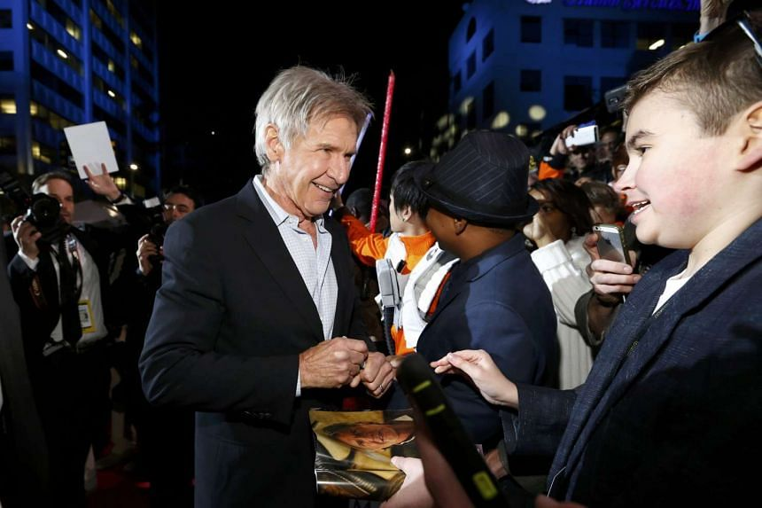 Ford greets fans as he arrives for the movie's premiere in Hollywood in December 2015.