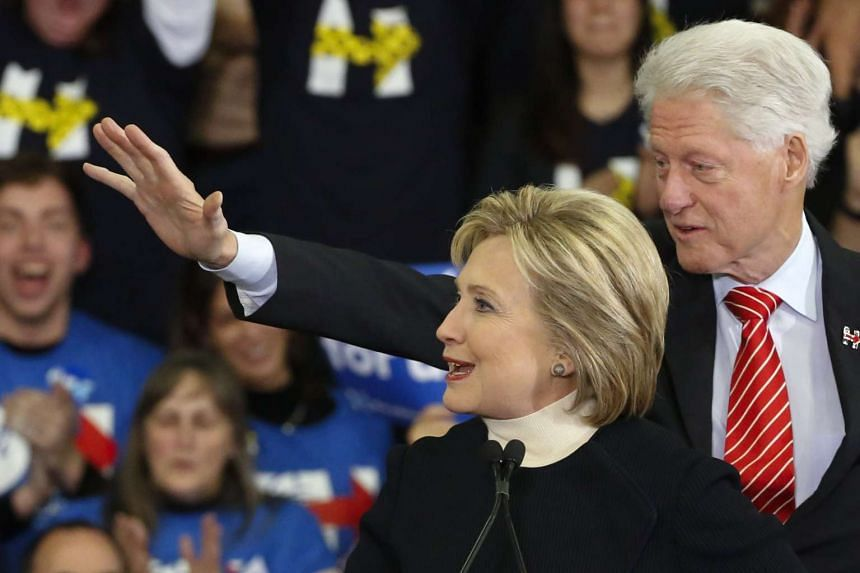 Hillary Clinton is accompanied by husband Bill Clinton at her rally in New Hampshire.