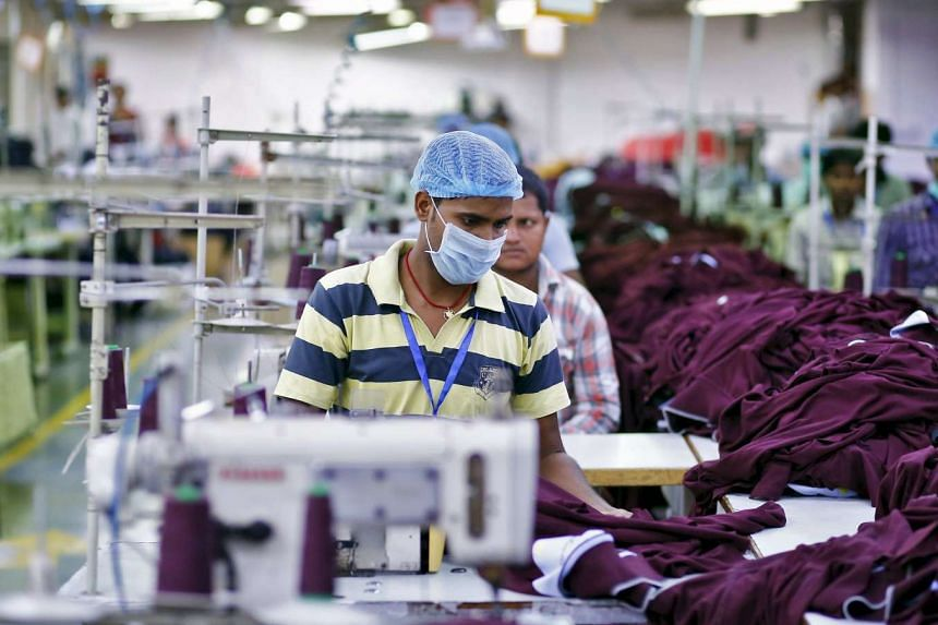 An employee working at a garment factory on the outskirts of New Delhi, India.