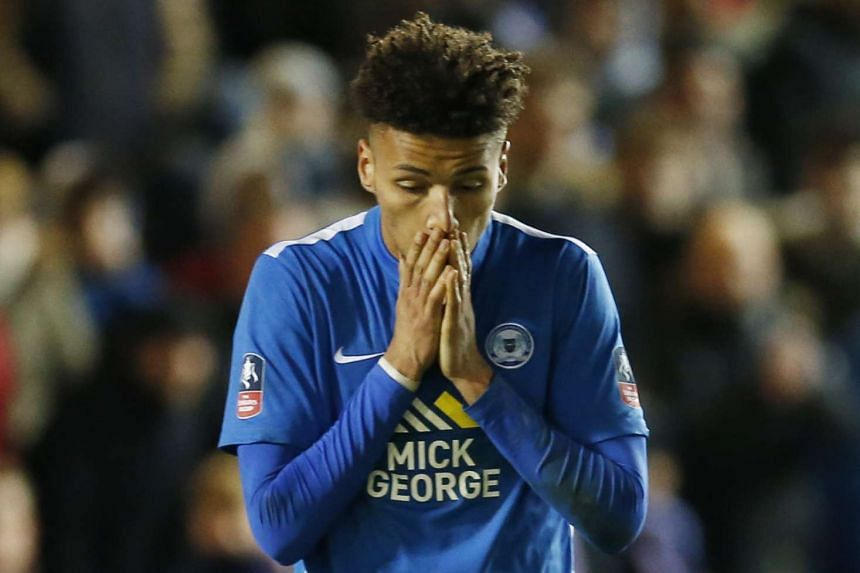 Peterborough's Lee Angol looks dejected after he misses during the penalty shootout.