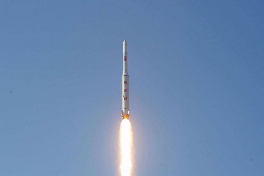 A North Korean long-range rocket is launched into the air at the Sohae rocket launch site.