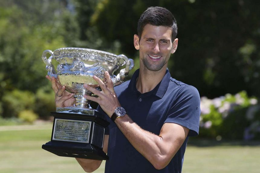Novak Djokovic poses with his trophy on Feb 1, 2016, after winning the Australian Open Men's Singles tennis tournament.
