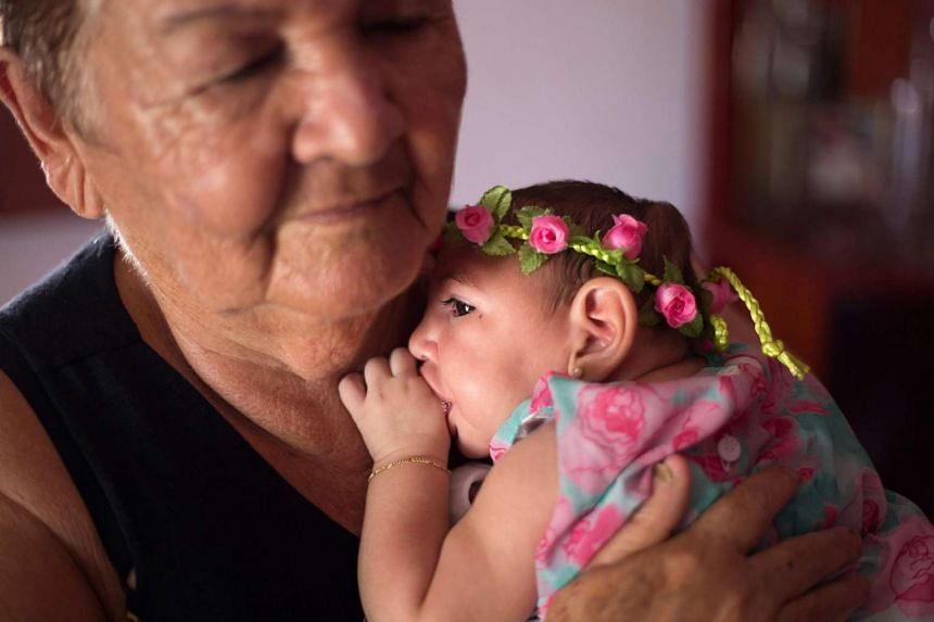 Ana Beatriz, a baby girl with microcephaly, celebrates her fourth months in Lagoa do Carro, Pernambuco, Brazil on Monday.
