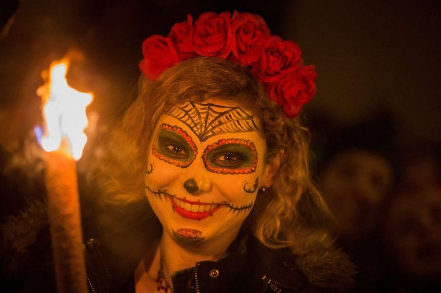 A woman smiles during the carnival in Cologne, Germany on Wednesday.