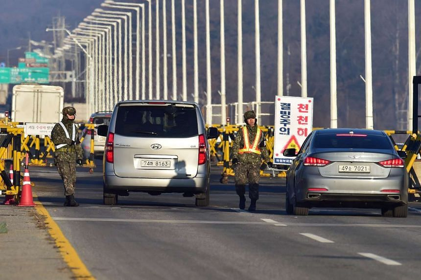 South Korean soldiers check vehicles on the road leading to North Korea's Kaesong joint industrial complex at a military checkpoint in the border city of Paju near the Demilitarised zone dividing the two Koreas on Monday.