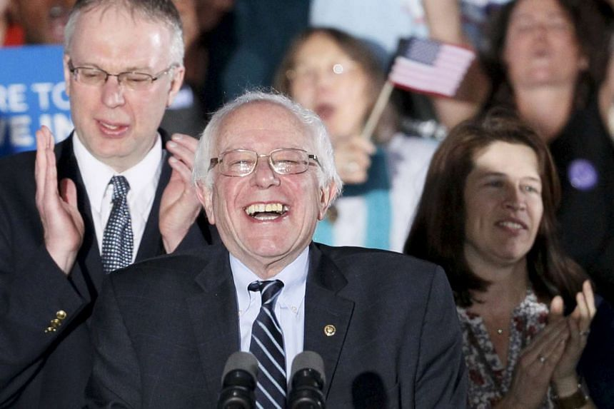 Democratic US presidential candidate Bernie Sanders smiles after winning at his 2016 New Hampshire presidential primary night rally in Concord, New Hampshire.