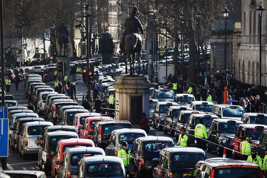 Thousands of London black cab taxis block Whitehall during a protest in central London on Wednesday.