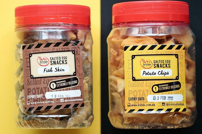 Irvin's salted egg potato chips (right) and fish skin.
