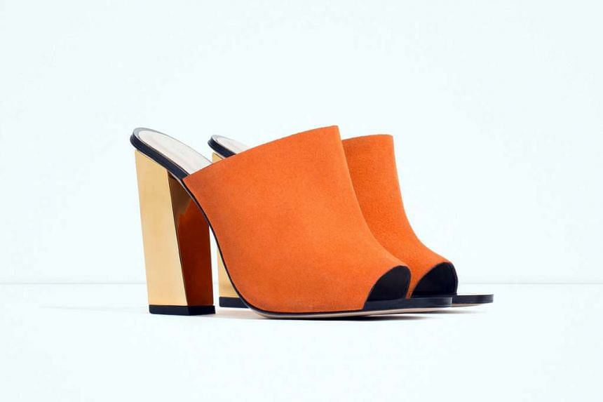 2. Orange leather mules with gold heels.