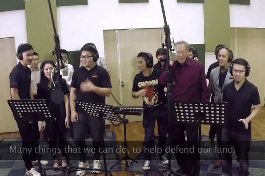 A teaser of the music video for the revised Total Defence song There's A Part For Everyone - featuring Defence Minister Ng Eng Hen (in purple shirt) lending his vocals - was put up on his Facebook page last week and has gone viral. The song and new m
