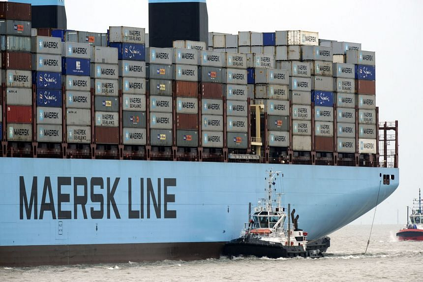 """Maersk Line, seen as an international trade bellwether as it controls about 15 per cent of global sea freight, was hit by a """"combination of low demand and high supply increase... in the second half of 2015"""", the group said."""