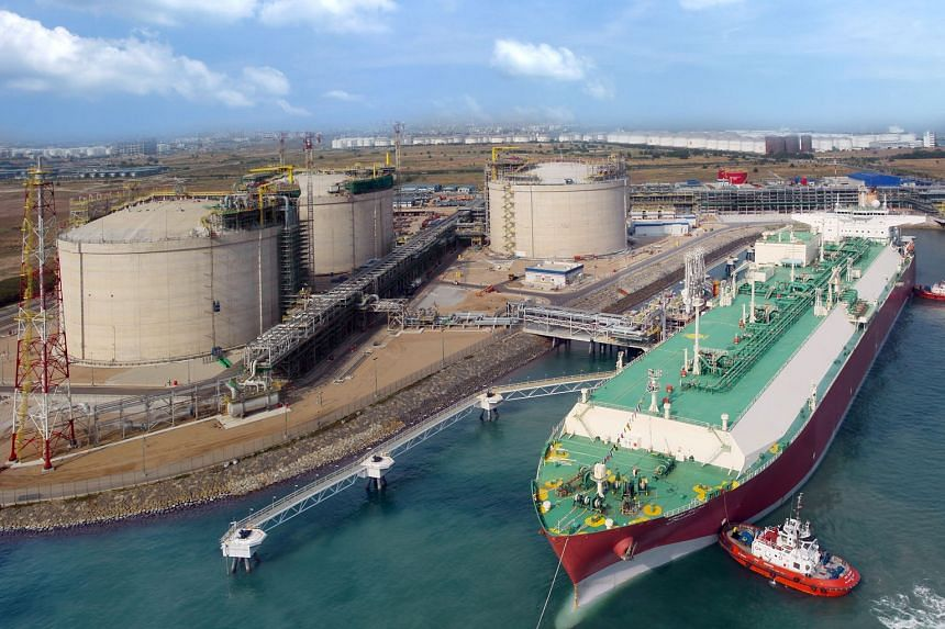 Singapore LNG Corp's liquefied natural gas terminal receiving its first cargo of supercooled natural gas in 2013. It will have a throughput capacity of 11 million tonnes by next year, when its fourth storage tank is up and running.