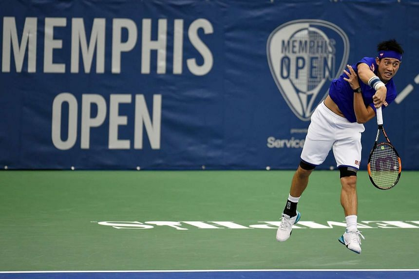 Kei Nishikori serves to Ryan Harrison during their singles match on Day 3 of the Memphis Open.
