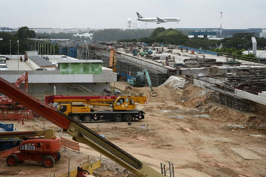 The new bridge linking the former South-end reservoir where the new parking stands for aircraft is currently being built and Changi Airport Terminal 4.