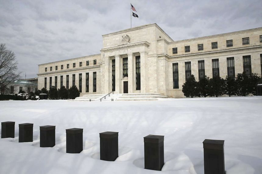 Snow covers the grounds of the US Federal Reserve in Washington.