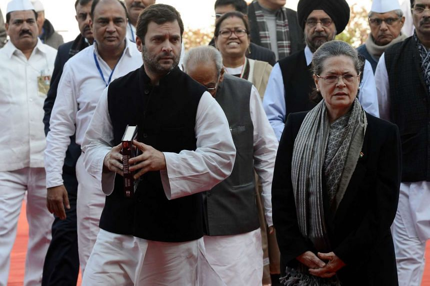 Sonia Gandhi (left) and her son Rahul (right) will have to face trial in a case involving alleged misuse of party funds.