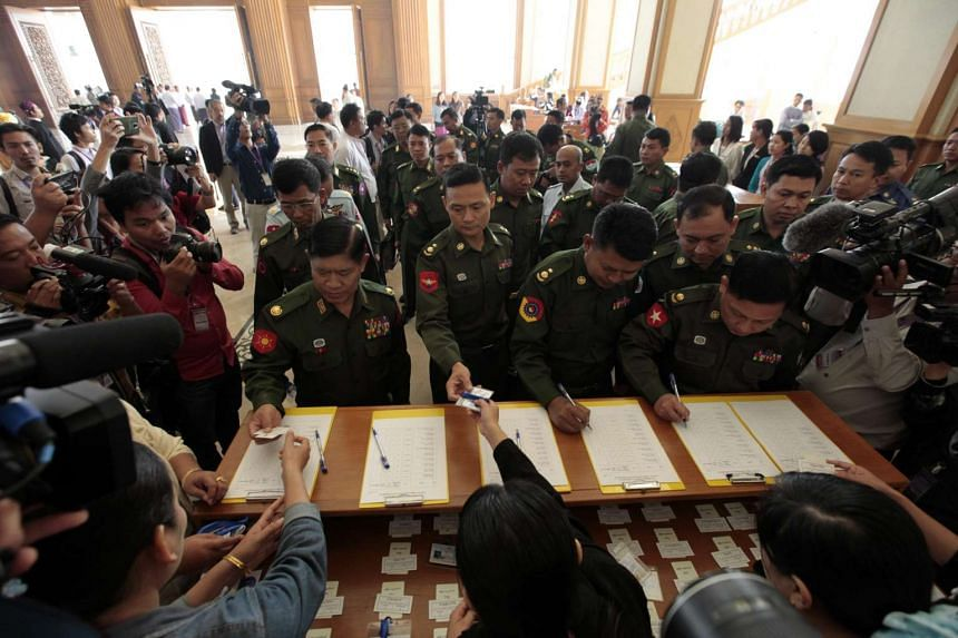 Military representatives of the parliament register during the first day of Amyothar Hlutta session in Naypyitaw on Feb 3, 2016.
