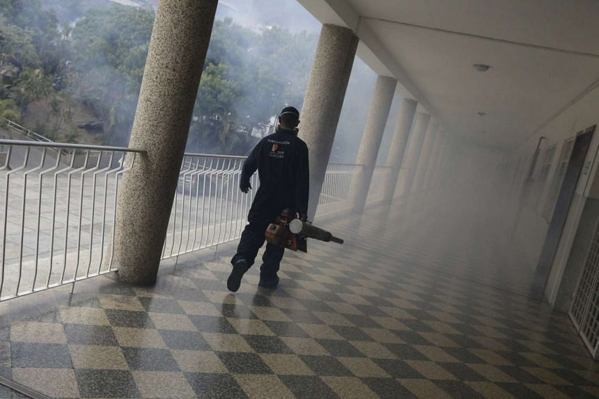 A municipal worker walking in a school during a campaign to help control the spread of the mosquito-borne Zika virus in Caracas, on Feb 5, 2016.