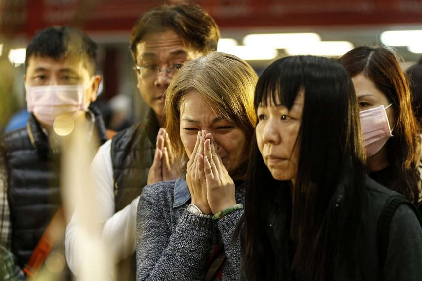 Grieving relatives attend a memorial service for quake victims in Tainan, Taiwan on Feb 12, 2016.