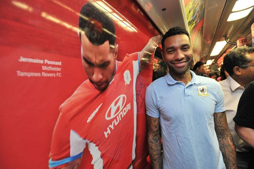 Tampines Rovers' Jermaine Pennant on an MRT train with his photo on it.