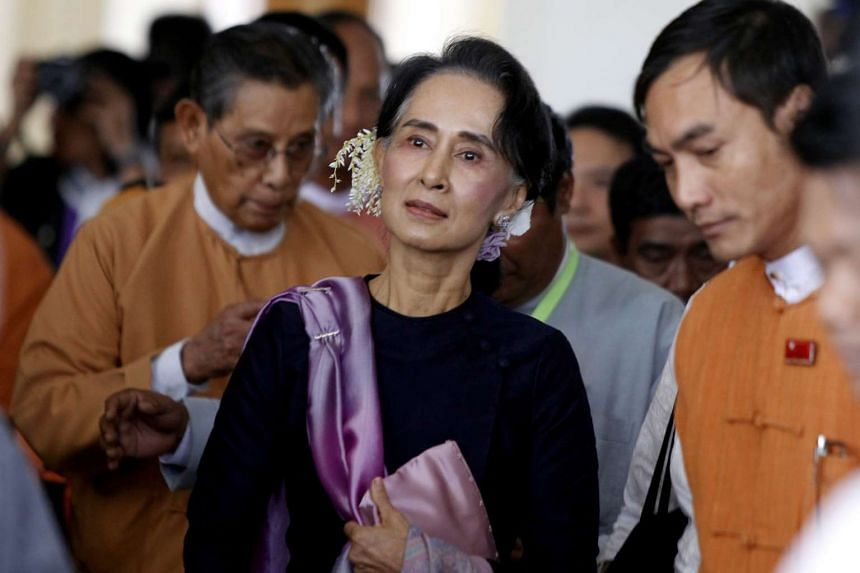 Aung San Suu Kyi (centre) has been given extra security after she received death threats on Facebook.