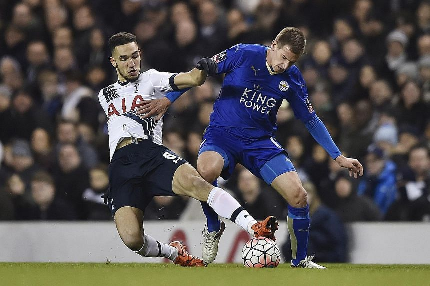 Leicester City's Marc Albrighton (right) holds off a tackle from Tottenham Hotspur's Nabil Bentaleb. With 13 more rounds to go this season, league leaders Leicester will do their utmost to continue to hold off any challenges from the teams below them