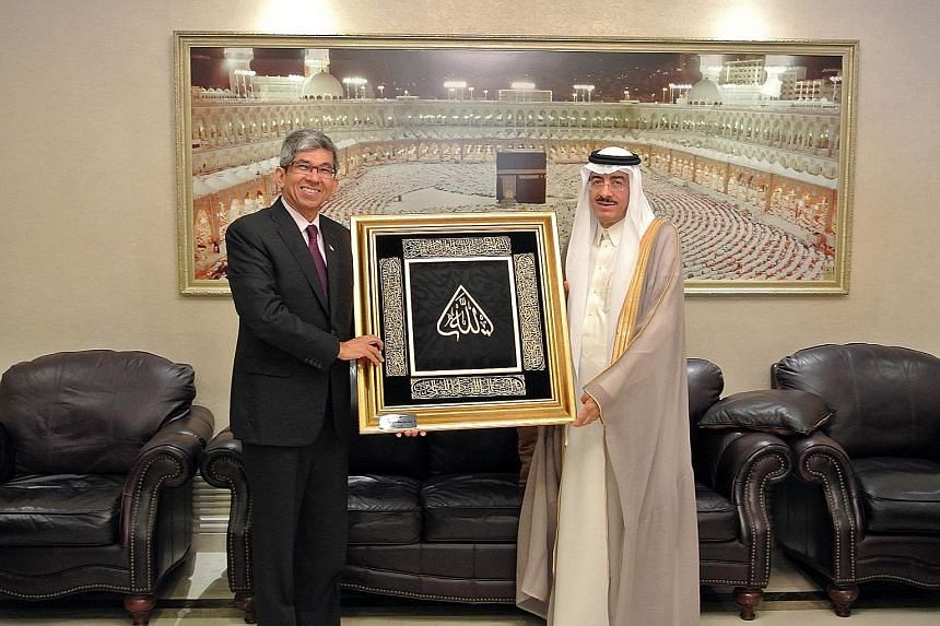 Dr Yaacob Ibrahim with Saudi Hajj Minister Bandar Mohammed Al-Hajjar during an exchange of gifts. Singapore has asked for its haj quota to be raised from 680 to 800 pilgrims a year.