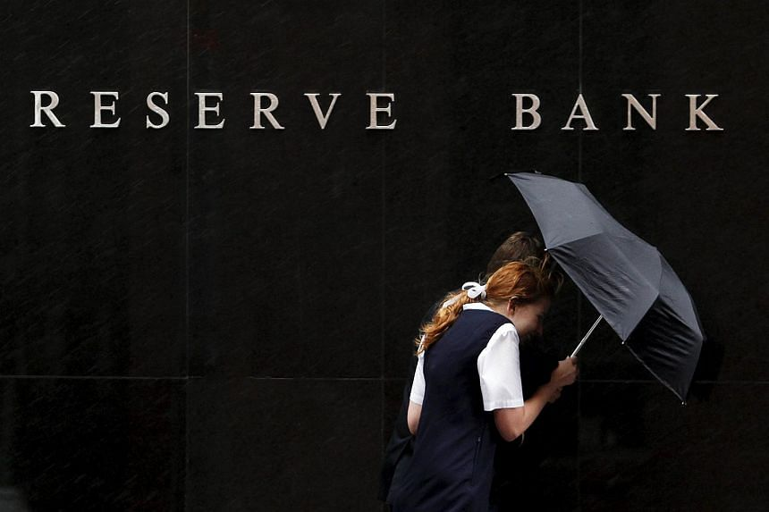People walk past the Reserve Bank of Australia building in central Sydney in this file photo.