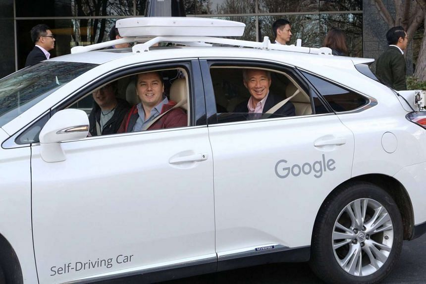 Prime Minister Lee Hsien Loong rides in Google's self-driving car in San Francisco on Feb 11, 2016.