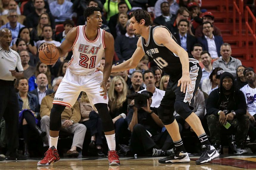 Hassan Whiteside of the Miami Heat posts up Boban Marjanovic of the San Antonio Spurs during a game on Feb 9, 2016.