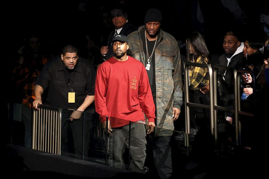 Kanye West (centre) arriving to present his third Yeezy collection at Madison Square Garden on Feb 11.