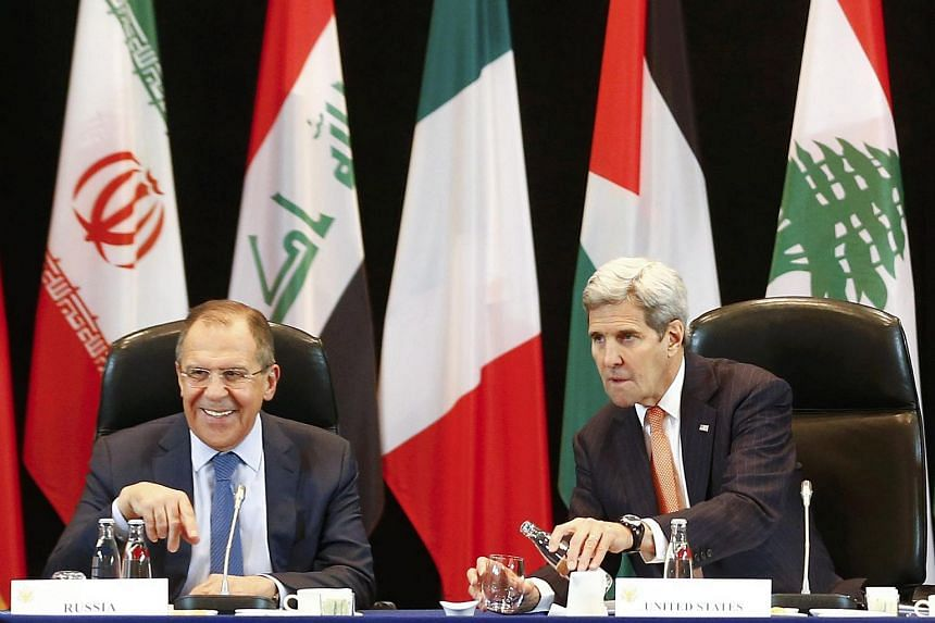 US Secretary of State John Kerry (right) and Russian Foreign Minister Sergei Lavrov attending an international meeting on the Syria crisis in Munich, Germany, on Feb 11.