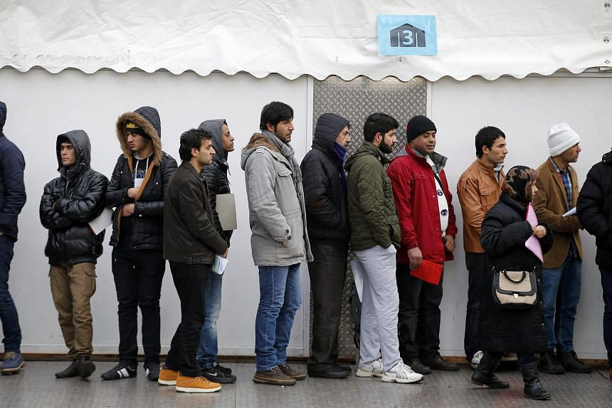 Migrants queueing at the Berlin Office of Health and Social Affairs for registration on Feb 5.