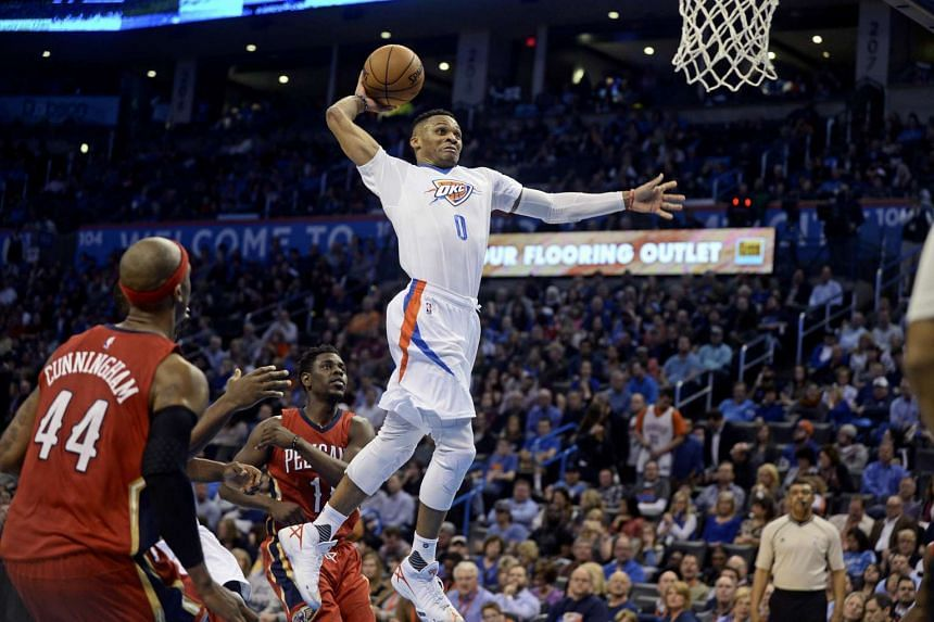 Oklahoma City Thunder guard Russell Westbrook dunks the ball against the New Orleans Pelicans during the third quarter at Chesapeake Energy Arena on Feb 11, 2016.