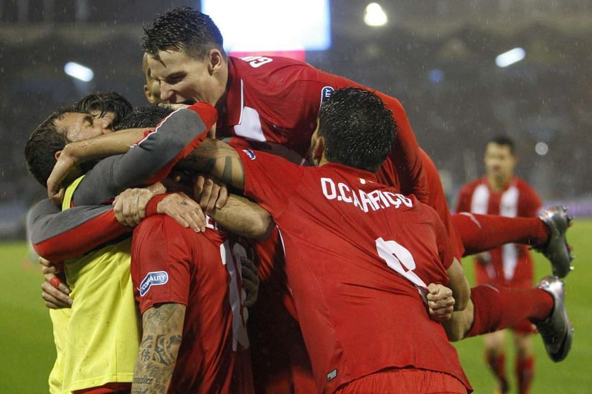Sevilla players celebrate their win.