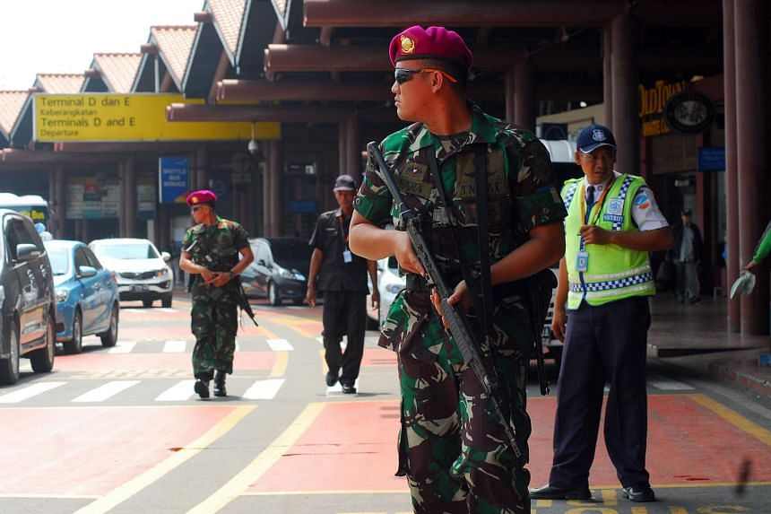 Indonesian soldiers securing the Soekarno-Hatta airport on Jan 14 after bomb attacks by militants in central Jakarta.